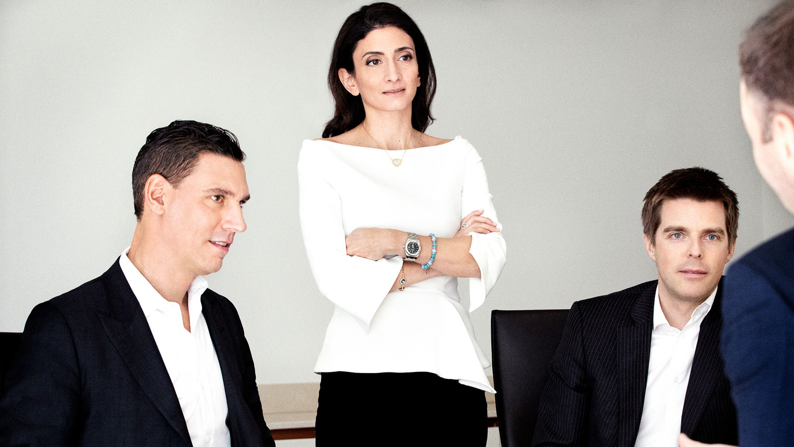 Partners Stefano Ferraresi, Tania Daguere and Christian Mogge meet in a conference room.
